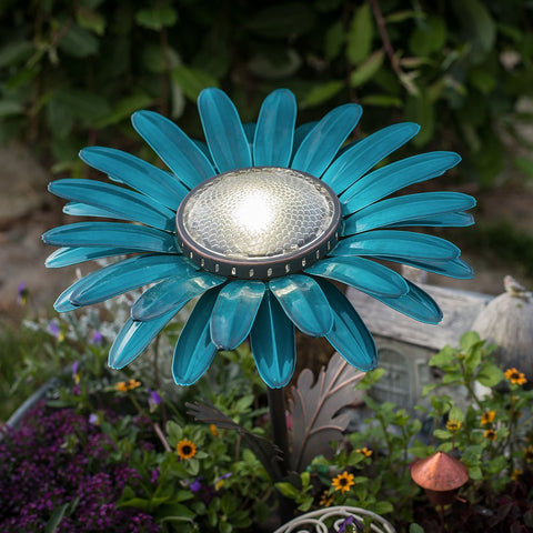 Our Teal Daisy Solar Light Garden Stake Statuary comes as a set of two and great for walkways, in between flowers and great with our cactus décor as well.
