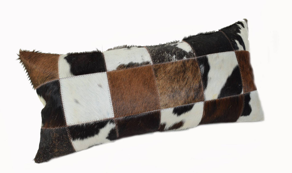 "Our Tri Color Cowhide Patchwork Lumbar Pillow is 20"" long x 12"" tall and features an assortment of black, brown, white, tan and probably some speckled colors of cowhide too… all patchworked together to make a decorative pillow."