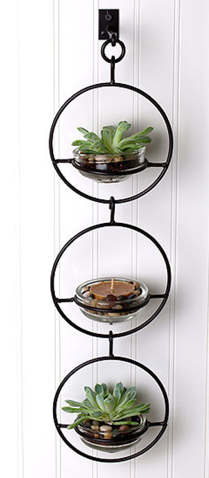 Our Triple  Metal and Glass Hanging Wall Terrarium / Candle Holder / Bird Feeder is a multi-functional item and can be used indoors or outdoors