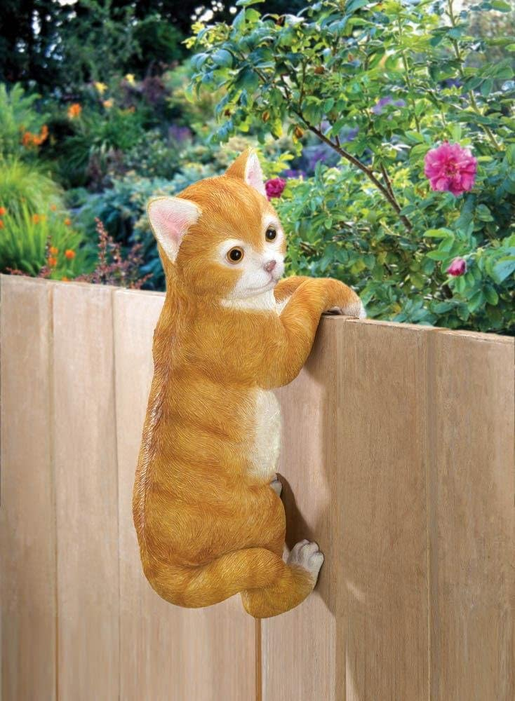 Our Climbing Peek A Boo Yellow Tabby Cat Garden Statuary hangs on by his front paws to a fence, planter, etc and exudes creativity and personality.