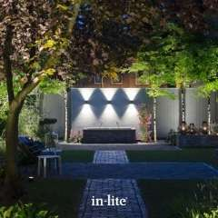 ACE UP DOWN 12v Wall lights illuminating water wall feature in garden at night