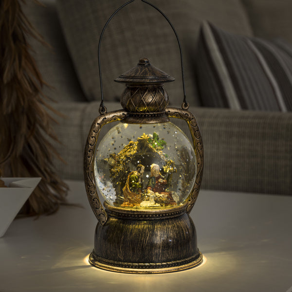 Konstsmide water filled lantern with nativity scene decorating table