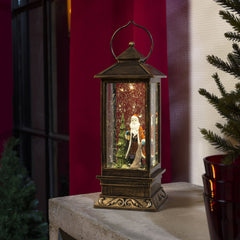 Konstsmide water filled lantern with Santa scene decorating table