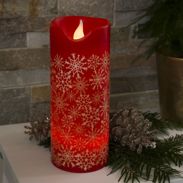 Konstsmide large LED red wax candle on table