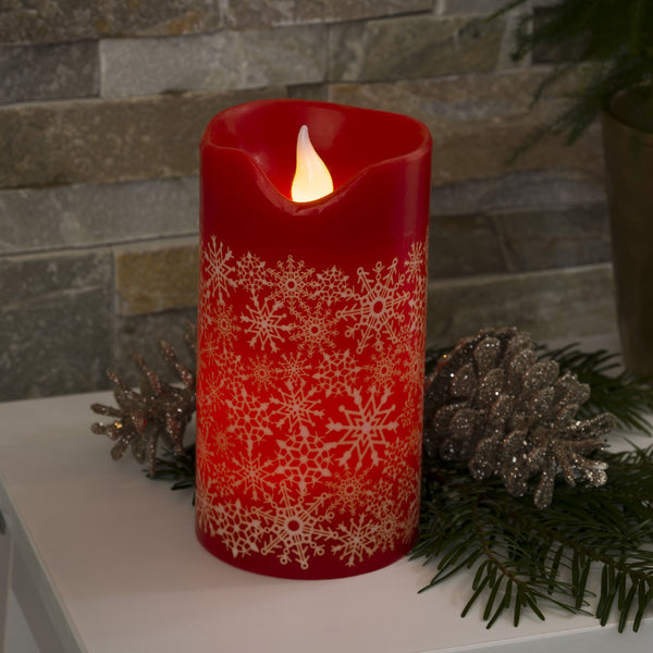 Konstsmide medium LED red wax candle on table