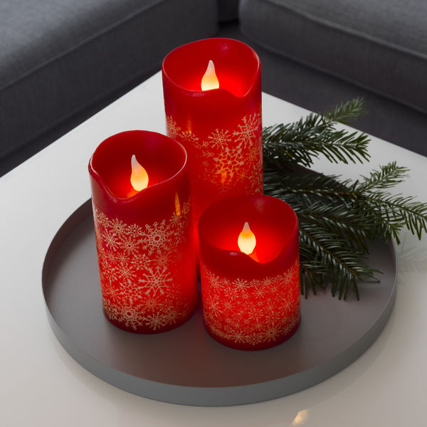 Konstsmide LED red wax candles on table platter