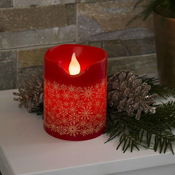 Konstsmide small LED red wax candle on table