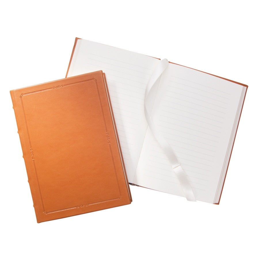 small hardcover leather journal with lined pages