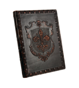 Ornate old world leather journal with embossed fleur de lis crest