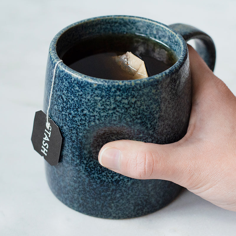 Stash Tea | This Cozy Tea Mug makes sure your thumb has a cozy place to rest when you're ready to wind down. Each artisanal mug has its own unique glaze and earthy tone.