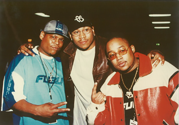 Daymond John founded FUBU with the help of celebrity endorsers like LL Cool J (center)
