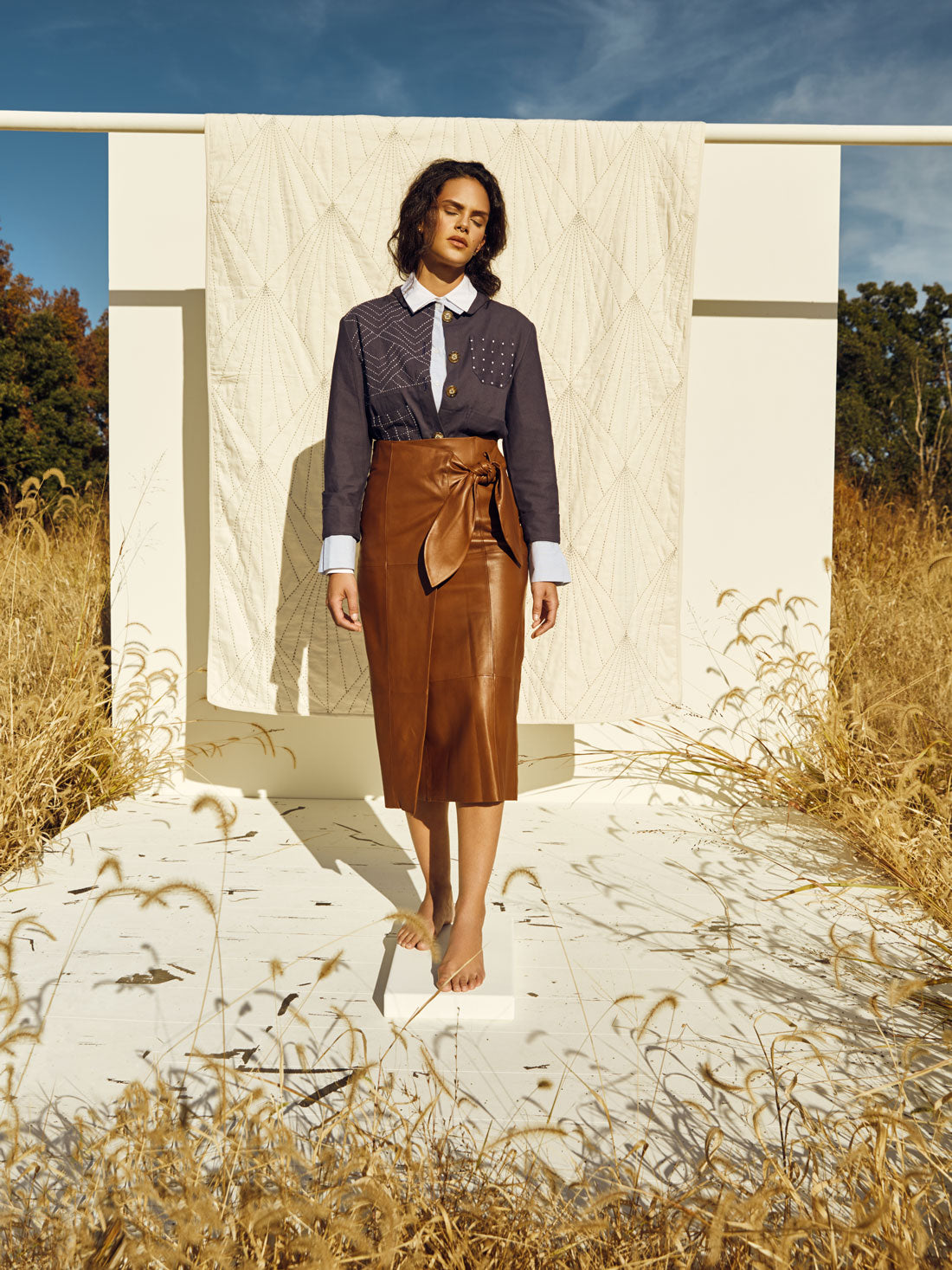 Anchal Navy Chore Jacket with Array Quilt in a Kentucky field, photographer Clay Cook