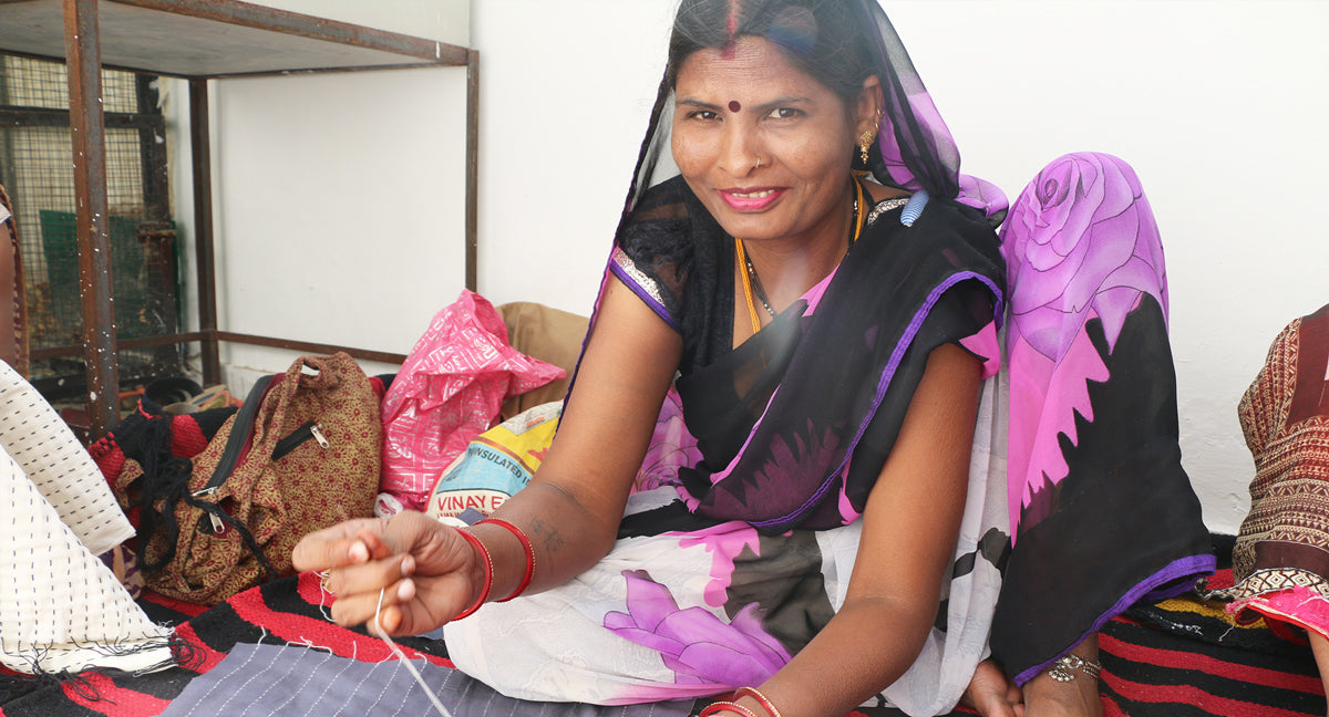 artisan choti working on kantha stitch