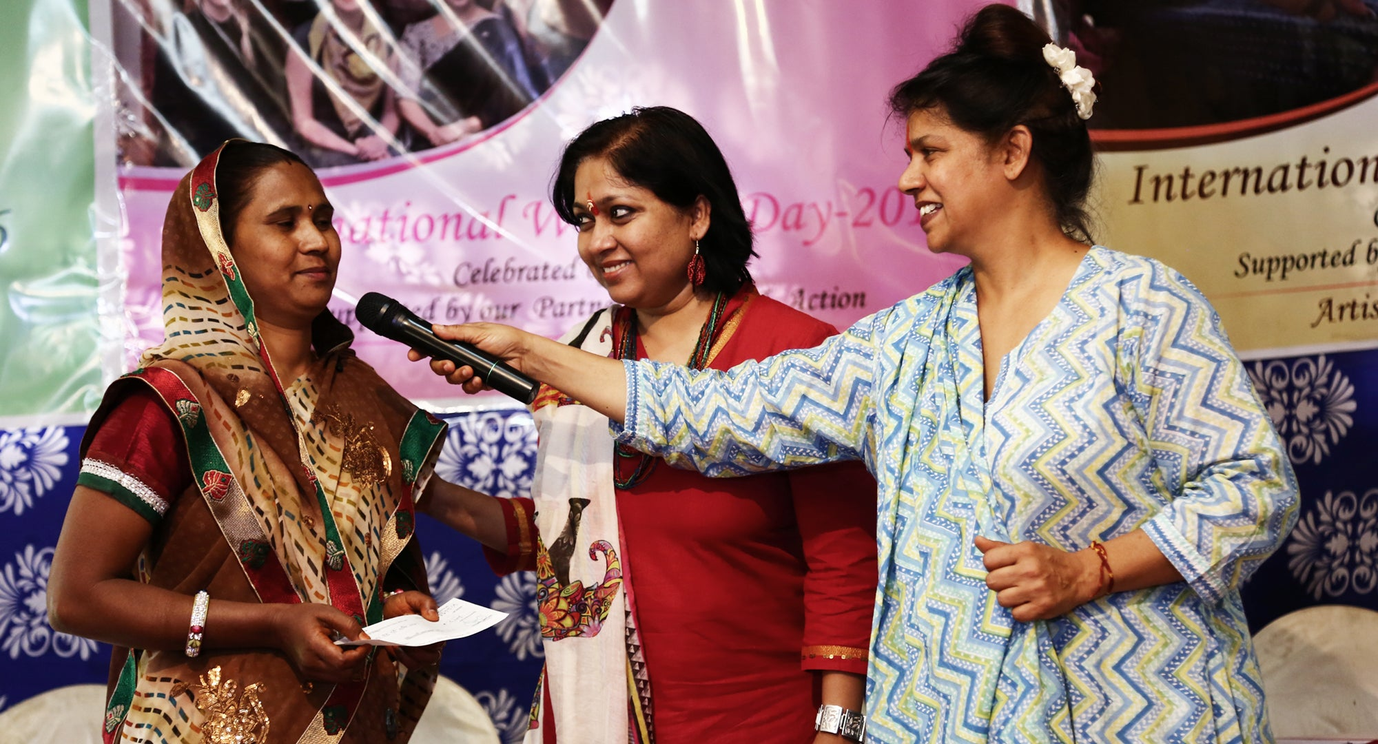 Lakshmi accepting  her award on International Women's Day
