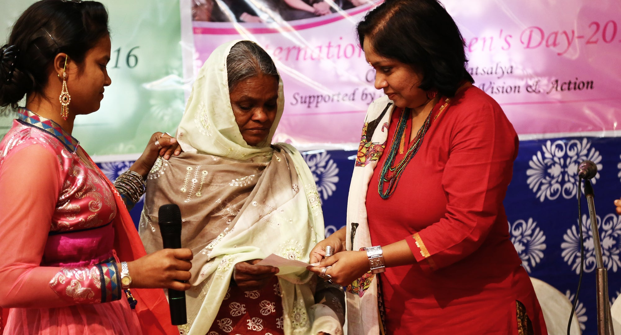 Nazia and mother accepting International Women's Day award