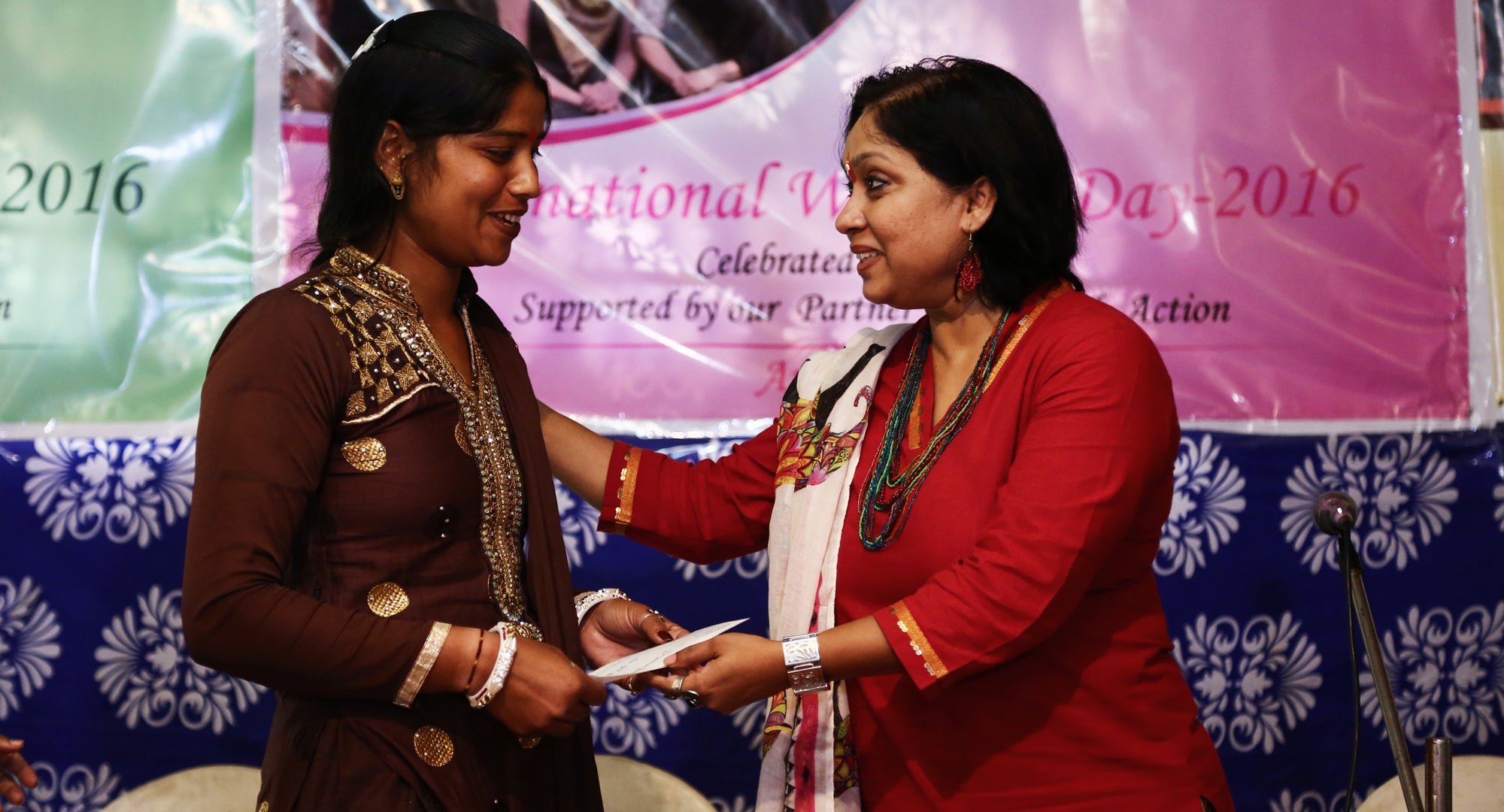 Maqsuda accepting International Women's Day award