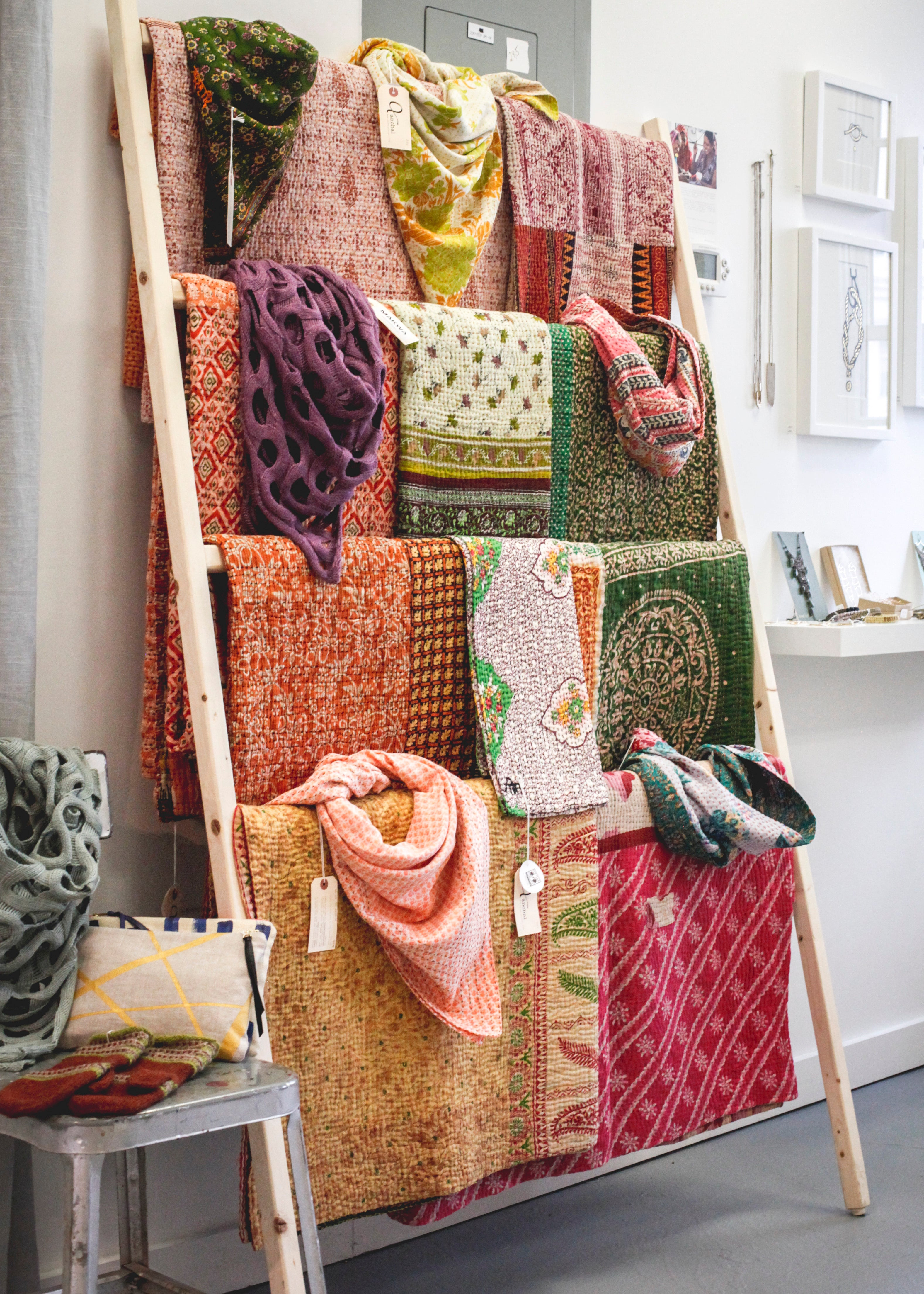 Rack of Anchal Quilts