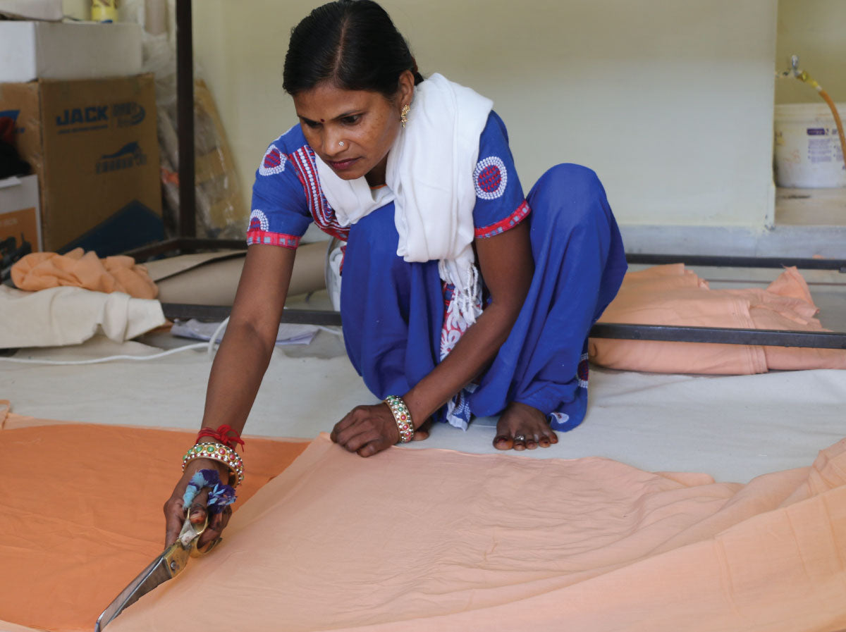 Shakuntela cutting fabric in 2018