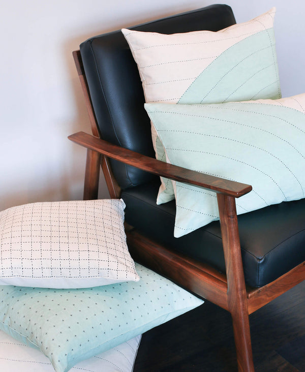 modern mint green throw pillows in mid-century vintage chair