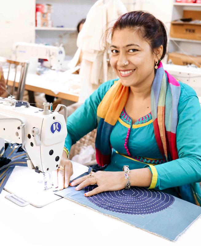 Anchal artisan using sewing machine