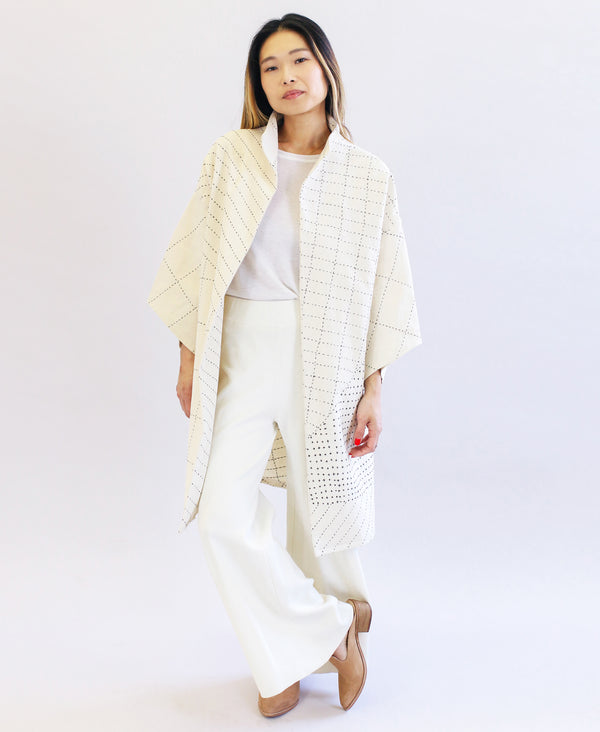 Bone white cocoon jacket made with organic cotton and embroidered details