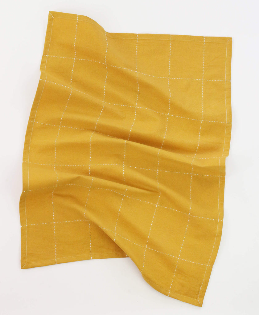 Anchal Project organic grid stitch tea towel in mustard yellow