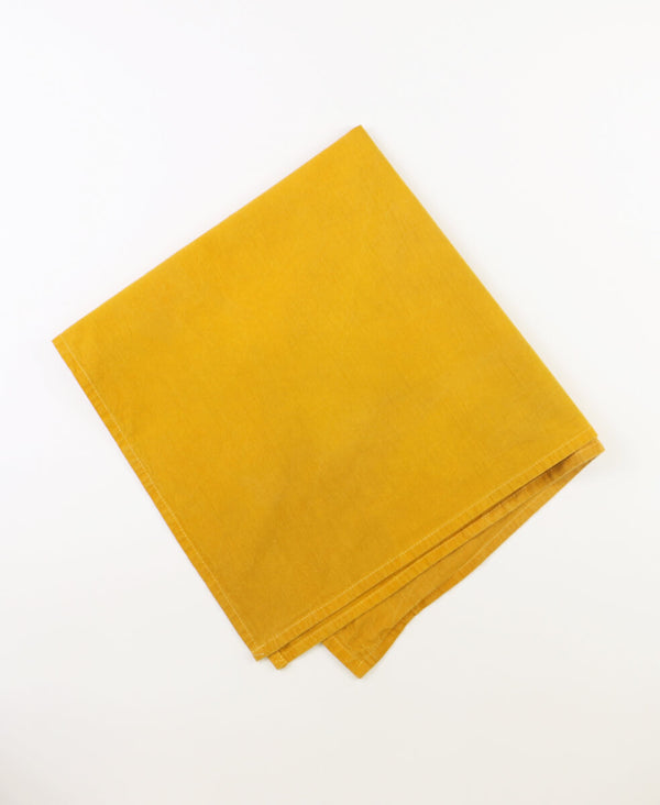 Organic cotton tea towel made using marigold flowers easily folds