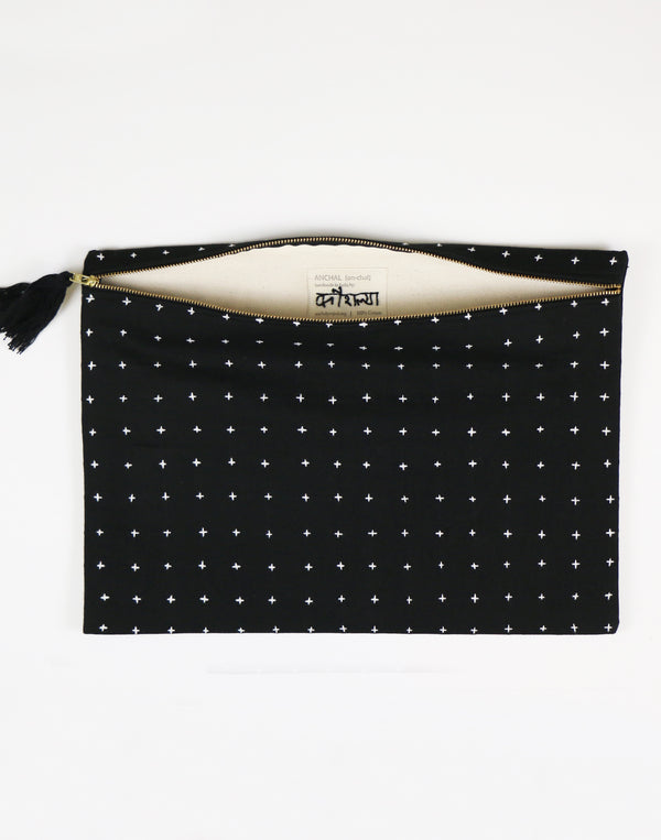 Spacious pouch featuring the hand-stitched name of its artisan maker