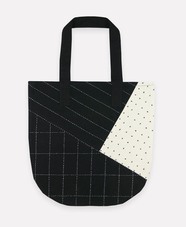 Organic-cotton tote bag with patchwork pattern hand-stitched by artisans