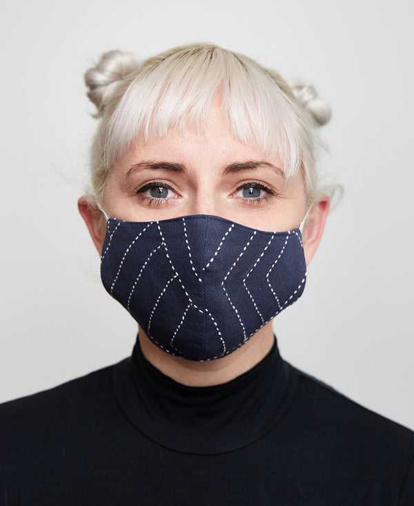 Fitted navy cotton face mask which helps to protect against the coronavirus