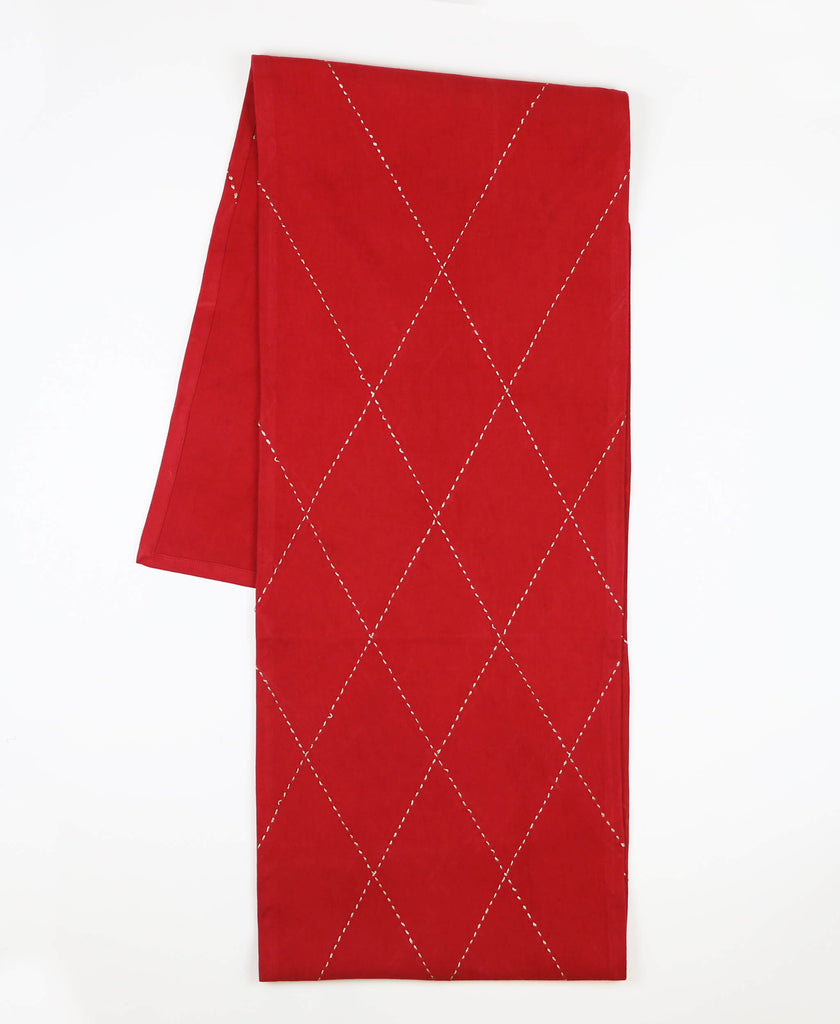 Anchal Project hand-embroidered red organic cotton table runner