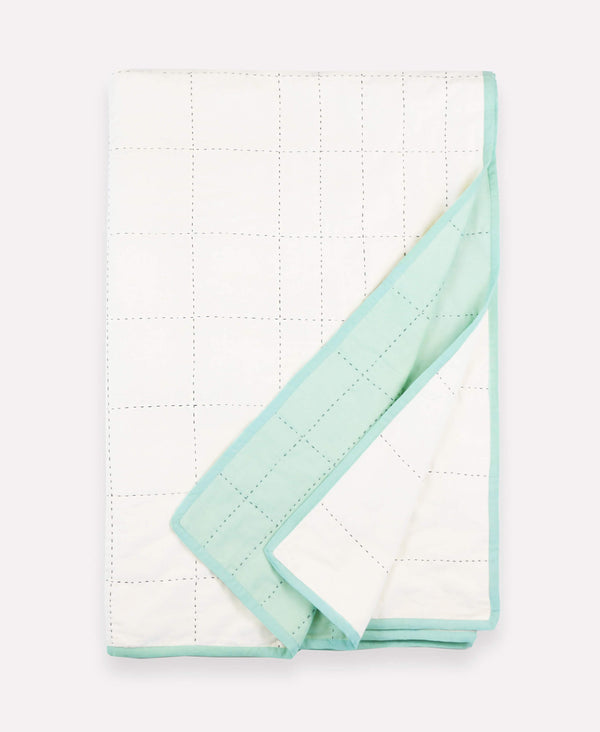 Sustainably made grid-stitch throw quilt in mint