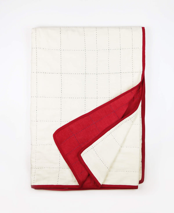 Grid-stitched organic cotton throw quilt made from eco-friendly organic cotton