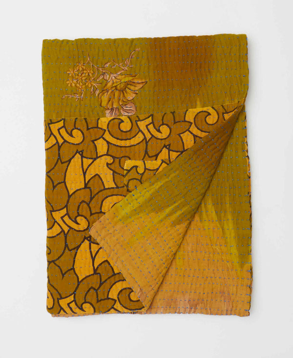 Gold yellow and green patterned bold kantha stitched quilt has a traditional look