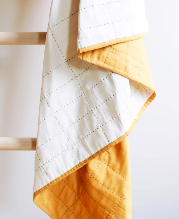 fair trade small throw quilt made from soft organic cotton