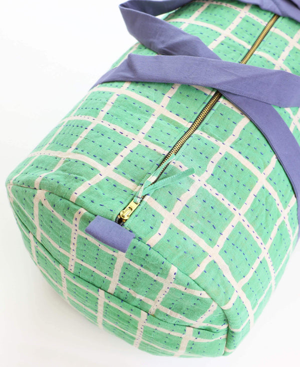 Zip closure on weekender duffle bag with neon teal pattern from vintage Indian saris