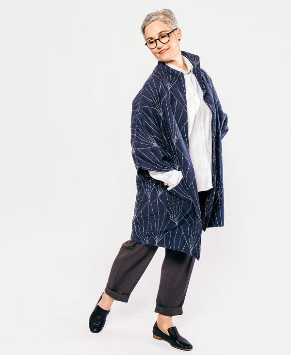 navy blue canvas cocoon jacket with minimalist design and hand embroidery
