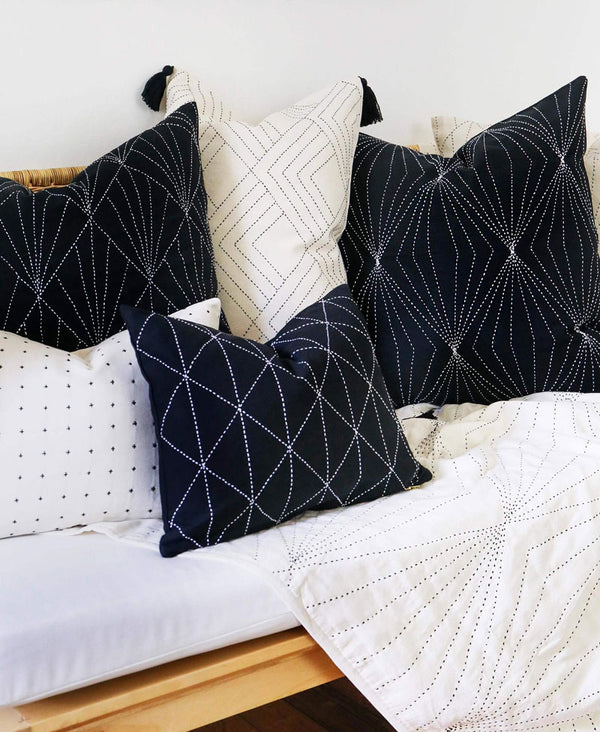 monochromatic contemporary pillow arrangement for sofa