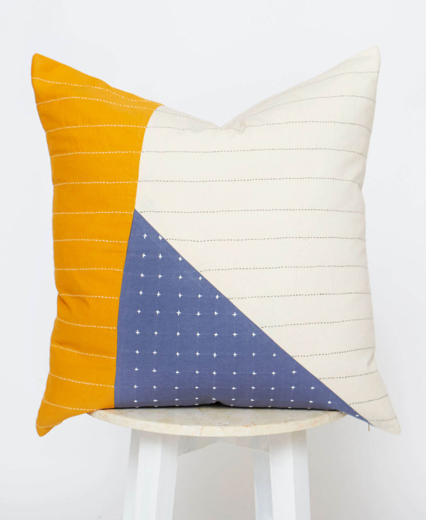 modern embroidered throw pillow with mustard blue and white colorblocking