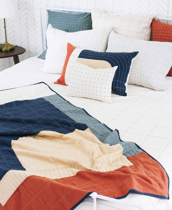 GOTS certified cotton throw quilt handmade and featuring a bold modernist composition