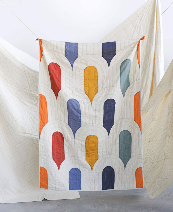 modern kantha quilt with arch design hand-stitched by Anchal artisans
