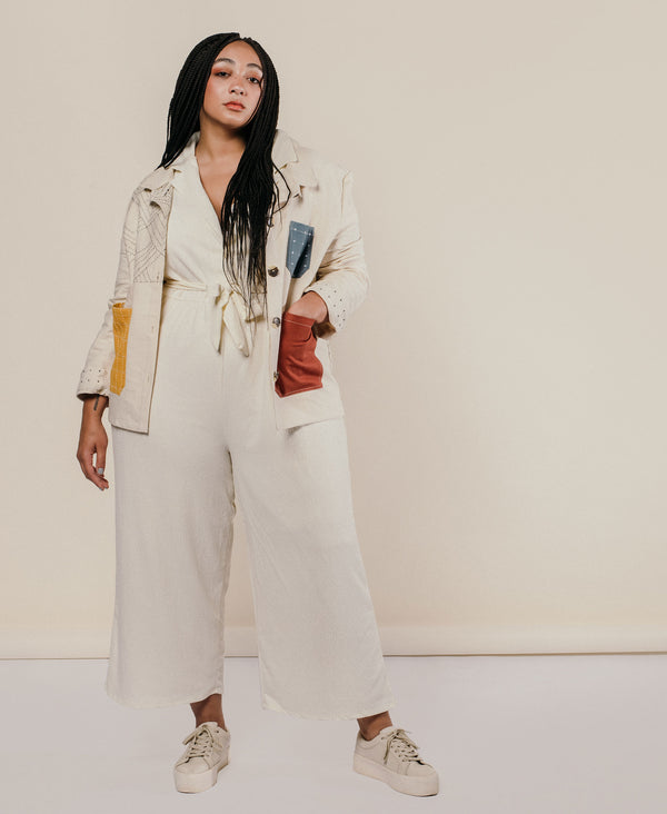 all neutral outfit with jumpsuit and colorblock chore jacket