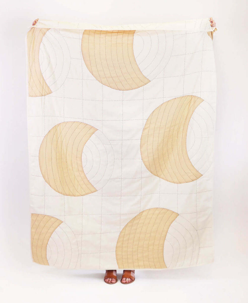 crescent lattice quilt throw made from organic cotton with traditional kantha stitching