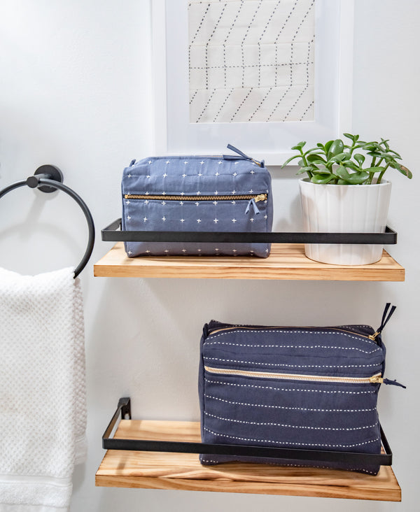 organic cotton toiletry bags on bathroom shelf by Anchal Project