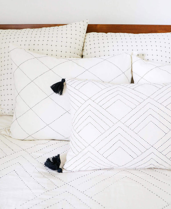 all white organic cotton modern pillow arrangement