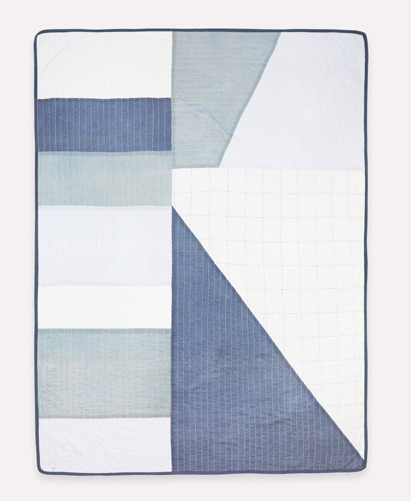 patchwork quilted throw blanket in shades of blue and gray