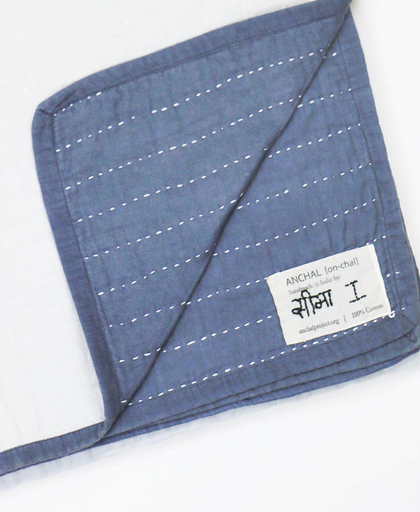 Kantha-stitched artisan-made quilt featuring the hand stitched name of the artisan maker