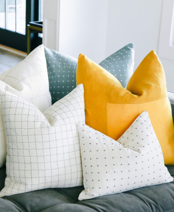 colorful pillow arrangement with hand-stitched Anchal Project pillows