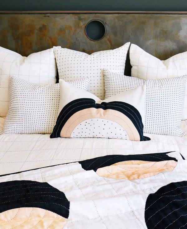 modern neutral color palette on bed with concentric design
