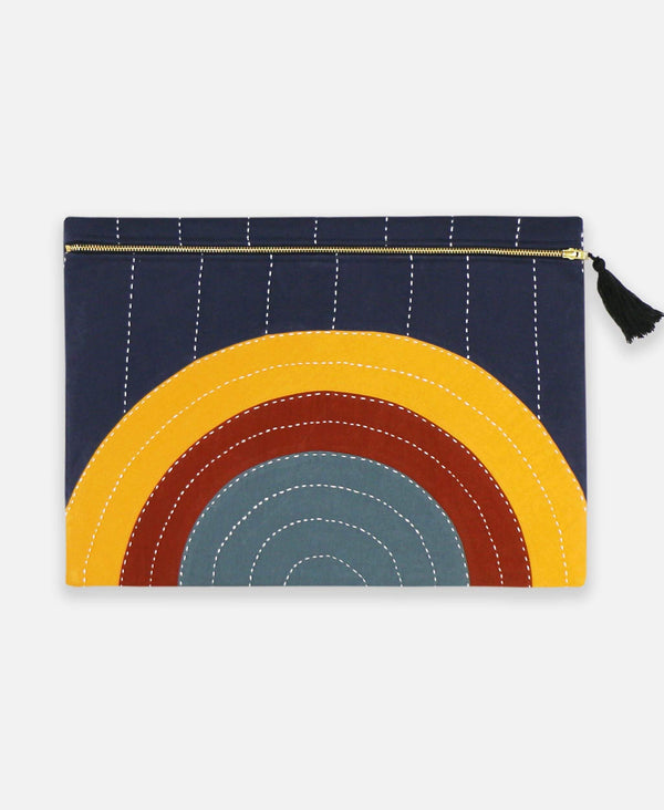 Anchal Project oversized pouch clutch with eclipse rainbow pattern made from organic cotton